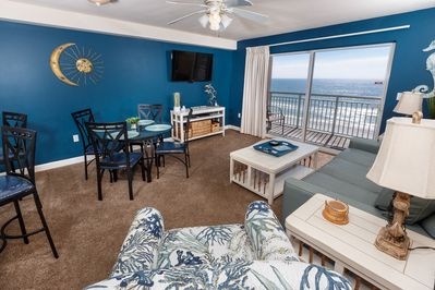Views of the gorgeous Emerald Coast seen from the living room, dining area, and kitchen of this condo.