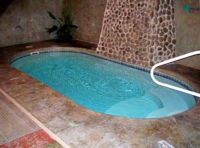 Indoor heated swimming pool with waterfall