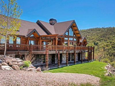 Photo for Custom log home nestled in the mountains. Stunning valley views from every room.