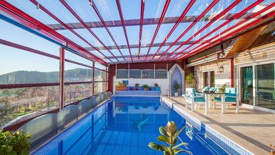 The swimming pool can be open to the sunshine in the summer months...