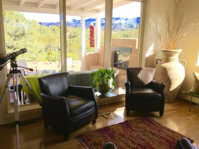 Living room seating area with view of Sangre de Cristo mountains