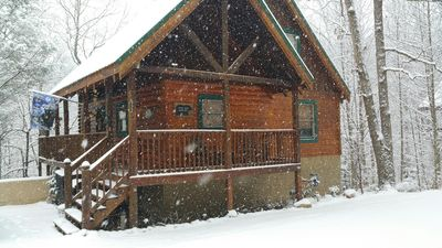 Front of cabin during snow flurries