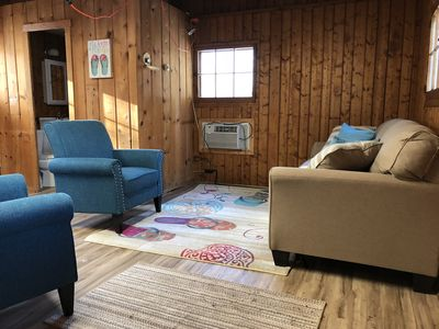 "Photo for Cozy ""Flip Flops"" Cabin in the woods with Pentwater Lake frontage and access"