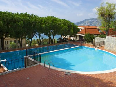 Photo for Elettra - Apartment by the pool with garden and tennis court