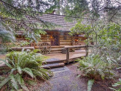 Photo for Rustic, pondfront log cabin with private hot tub & wood fireplace