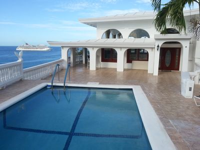 New Pool & sun deck East Side; In background cruise ship arriving at harbor
