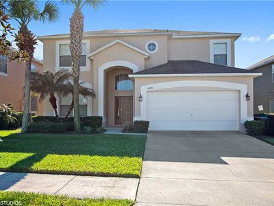 Photo for Luxurious 6 bedroom 4.5 Bath Pool Home Located less than 5 miles of Walt Disney World