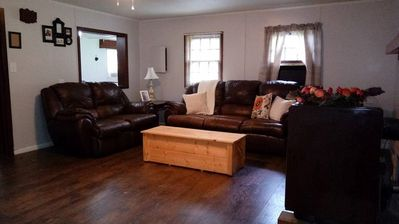 15x15 sq. ft. livingroom with reclining sofas, 50in. TV