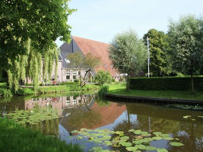 Photo for Family apartment in an old farmhouse with a jetty, walking distance of Sneek