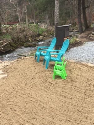 Enjoy sitting by the stream on our beach area.....