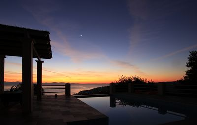 Photo for Private villa with spectacular view,Infinity pool,just 3 minutes drive to Gaios