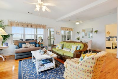 Living dining area opens directly to the large ocean front screened porch.