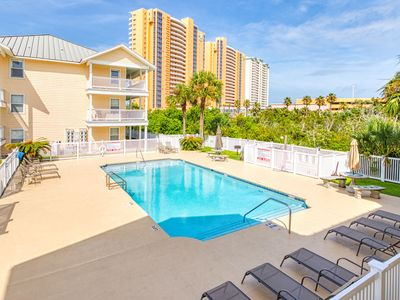 Photo for Coastal condo with complex pool - across the street from the beach