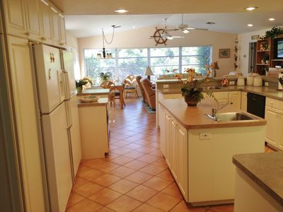 Spacious Kitchen and family room over looking canal and private dock