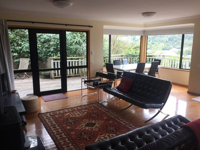 Lounge and dining room with private bush views through to Lake Tarawera.