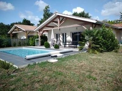 Photo for Landes holidays between lake and ocean in a pleasant house with swimming pool