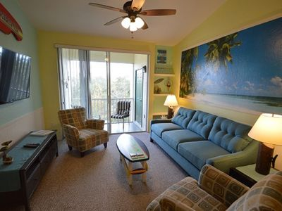 Photo for Pool view, screened balcony, full kitchen, close to Disney, gates resort, gym
