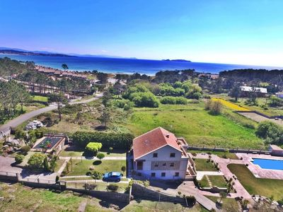 Photo for Lovely apartments with swimming pool just 150m. from the beach