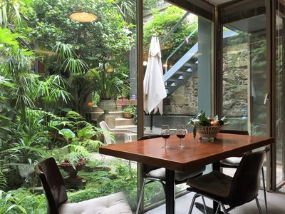 Dining area glassed over the garden and red fish pond