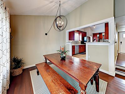 Dining Area - Enjoy festive vacation meals at the farm-style table.