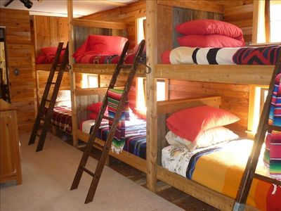 bunk beds each with window and Pendelton blankets. Kids go crazy over this room!