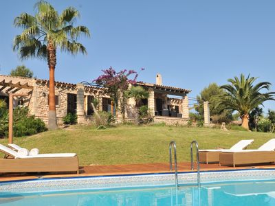 Photo for Villa in landscaped garden with pool in nature reserve and near the beach