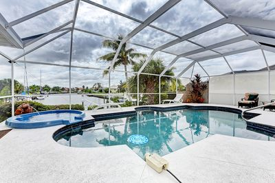 South facing lanai with heated pool and stunning canal views