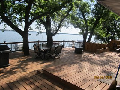 Lakeside deck with a gas firepit and grill