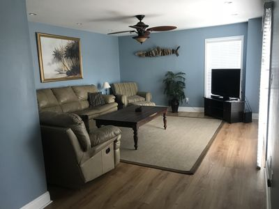 The living room with a lot of natural light!
