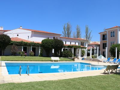 Photo for Large apartment of 2 suites with air conditioning, large garden and swimming pool