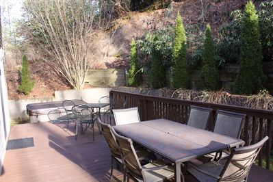 Deck with grill, hot tub and seating for 10 and umbrellas in the summer