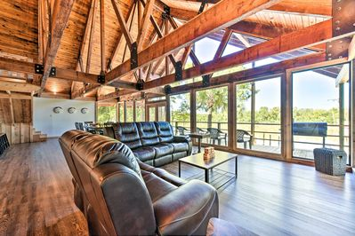 This luxury Houston vacation rental home sits right on the San Jacinto River!