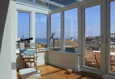 Conservatory with view of St Ives bay