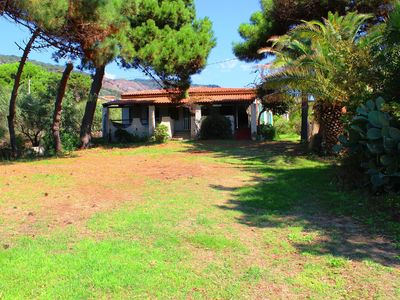 Photo for Semi-detached villa with garden, veranda with sea view, only 20 m from the sea.
