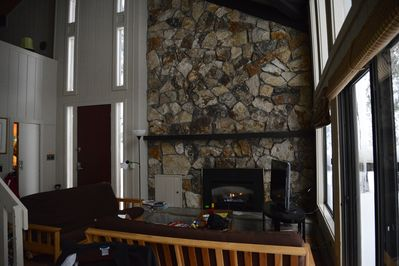 cozy break room with natural rock fireplace