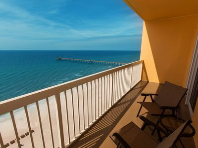 Photo for Tropical touches abound w/ a private balcony, shared pools, gym, & beach access