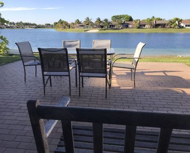 Back patio on lake, there's a little beach around the fence, right side of house