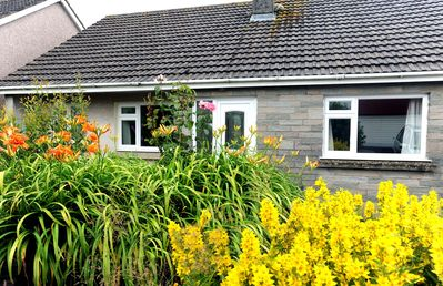 Photo for Peaceful Cottage, WiFi, Parking, Enclosed Garden, Walk to Beach