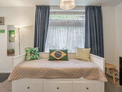 Photo for Compact and comfortable one-bedroom apartment with garden, for up to four guests, in the trendy and