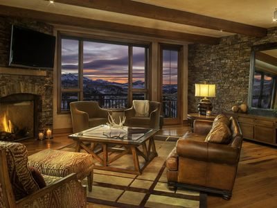 Enjoy gorgeous views from any of the many seating options of the living room.