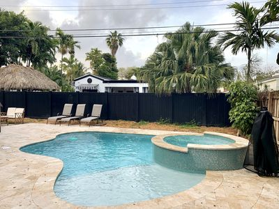 Photo for Heated saltwater pool w/ jacuzzi 10 min to SOBE