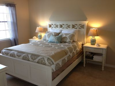 Enjoy a restful night sleep in this luxurious queen bed with private bathroom.