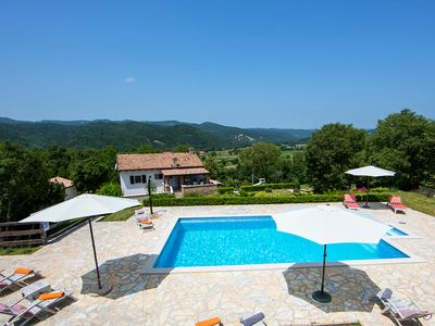 Photo for This 4-bedroom villa for up to 10 guests is located in Boljun and has a private swimming pool, air-c