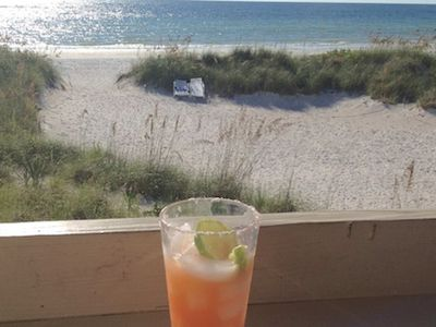 Enjoy a Refreshing Beverage out on the Private Patio that overlooks the Breathtaking Crystal Blue Waters of Indian Shores, FL
