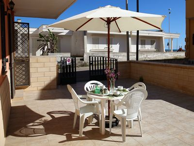Photo for Comfortable apartment in a superb location only 50m from the beach of Torre Mozza