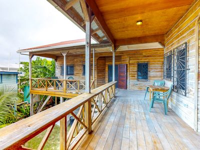 Photo for Elegant Caye Caulker home with spacious balcony & separate suites