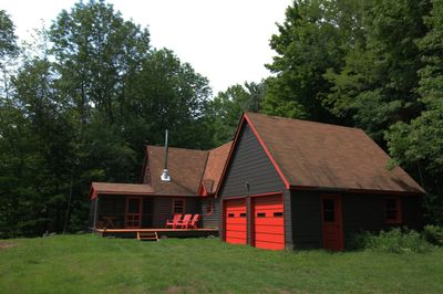 The cottage and garage with plenty of parking in the Catskills