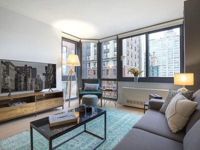 Photo for Terrific Tribeca 1BR, Gym, Roof deck, Indoor pool by Blueground