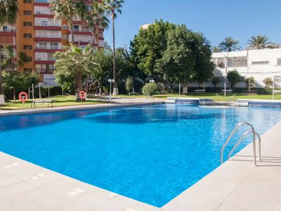 Photo for Air-Conditioned Apartment On The Beach and Close to Puerto Marina with Balcony, Pool, Garden & Wi-Fi