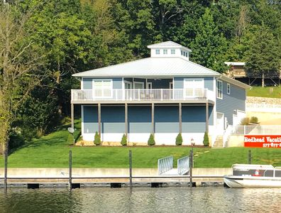 The Blue home. Waterfront and comes with a dock.